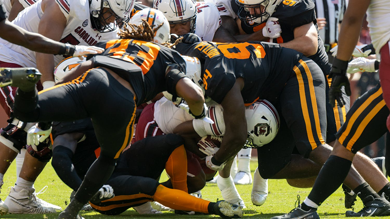 Freshman running back Juju McDowell rushes into a wall of Volunteers after the ball handoff from sophomore quarterback Luke Doty on Oct. 9, 2021. McDowell would carry 8 times for 41 yards.
