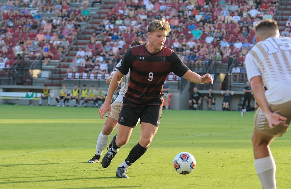<p>Sophomore defender Christian Kraus receives a pass from a teammate during the season opener against the College of Charleston Cougars. The Cougars beat the Gamecocks 1-0 with a goal during overtime.&nbsp;</p>