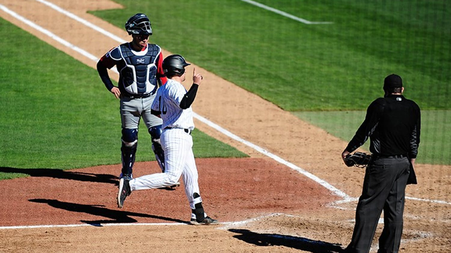 Sophomore catcher Colin Burgess scores against Dayton. South Carolina swept the three-game series against the Flyers to open the 2021 season.