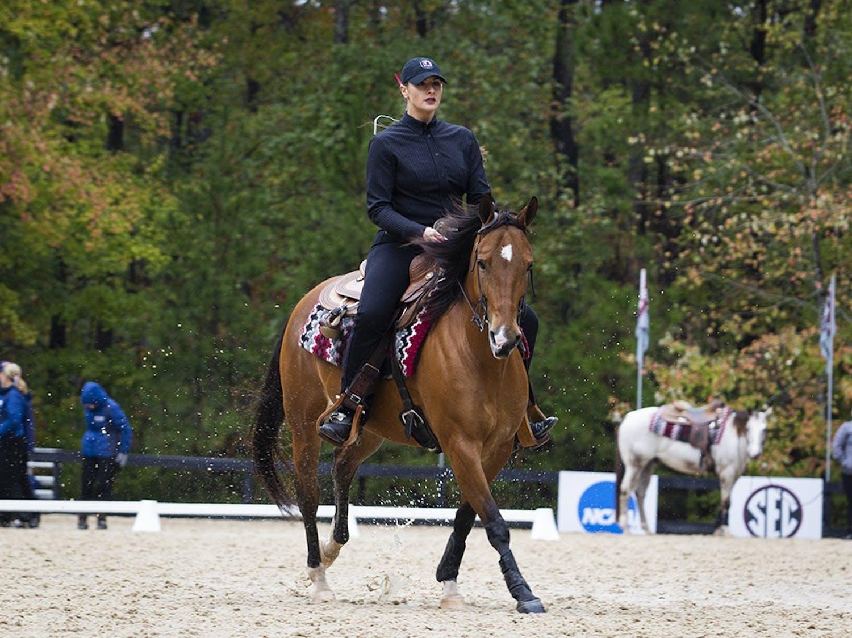 South Carolina junior Addie Cromer riding on Nike during their reining event. Cromer scored a 67.5.