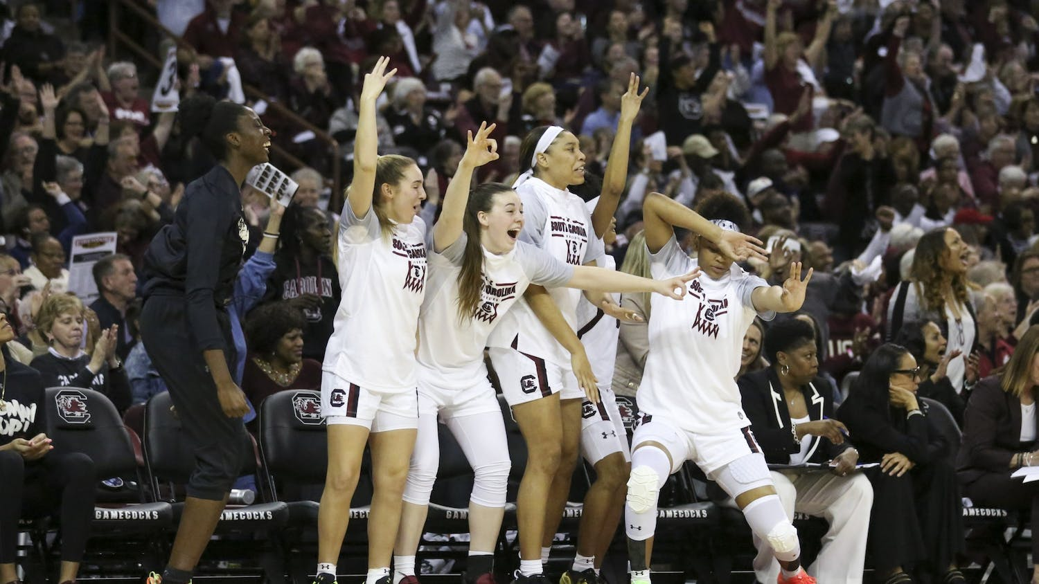 South Carolina's bench celebrates after one of its players scored a 3-point shot during the second half. The Gamecocks had multiple 3-point shots to start the second half.