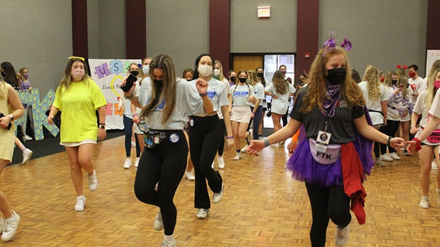 """Dance Marathon attendees and volunteers doing the """"Cha Cha Slide."""""""