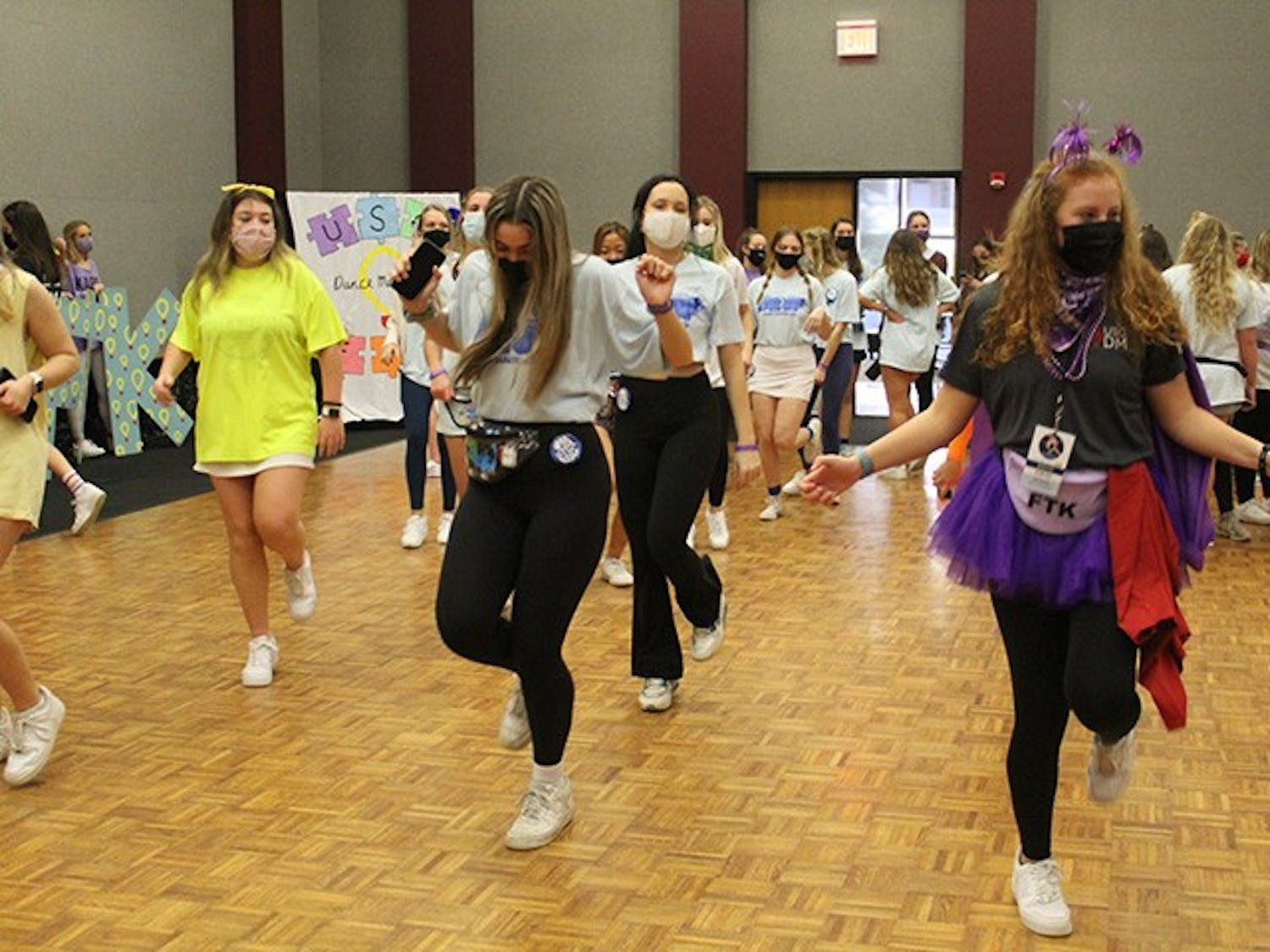 "Dance Marathon attendees and volunteers doing the ""Cha Cha Slide."""