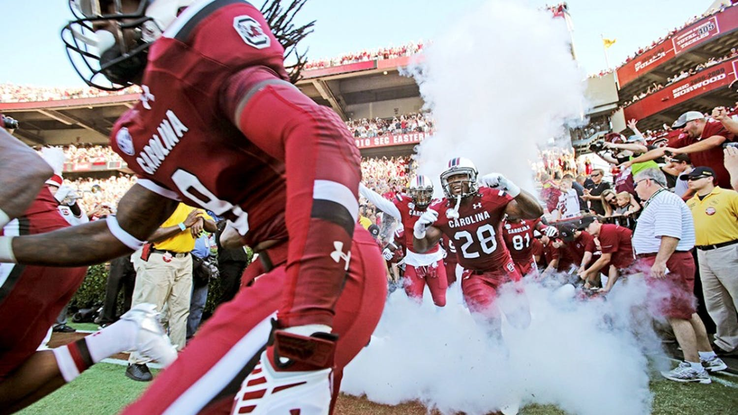 South Carolina running back Mike Davis (28) and the rest of the Gamecocks head onto the field prior to the start of action against Texas A&M at Williams-Brice Stadium in Columbia, S.C., on Thursday, Aug. 28, 2014. (Gerry Melendez/The State/MCT)