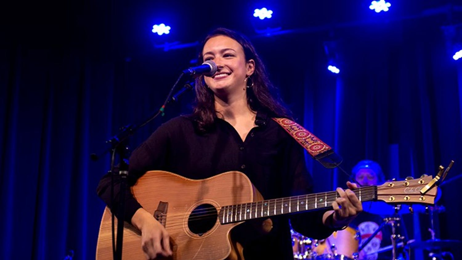 """Mia Green performed in July 2018 at Isis Music Hall in Asheville, North Carolina. The songs she performed were released on her """"Paper Days"""" album."""