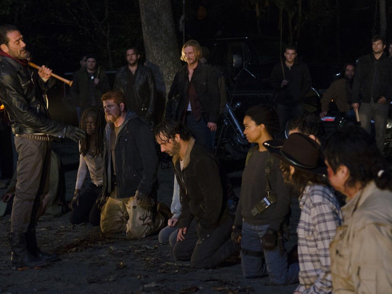 "Negan (Jeffrey Dean Morgan) stands before Michonne (Danai Gurira), Abraham (Michael Cudlitz), Maggie (Lauren Cohan), Rick (Andrew Lincoln) and Sasha (Sonequa Martin-Green), Carl (Chandler Riggs) and Eugene (Josh McDermitt) during the final cliffhanger scene of season six of AMC's ""The Walking Dead."" (Gene Page/AMC)"