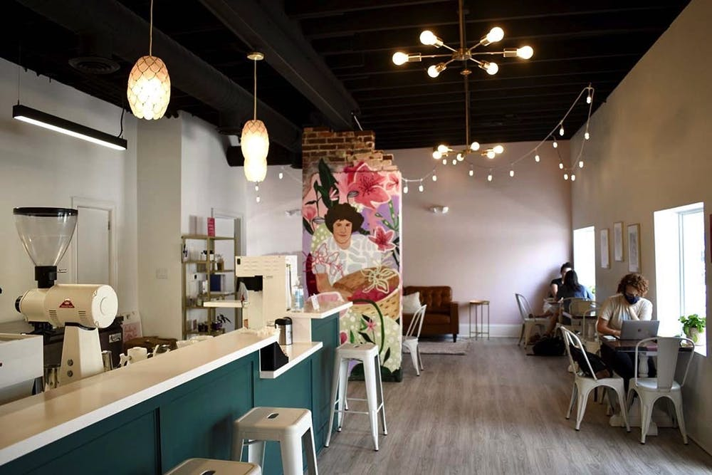 <p>The interior of Azalea Coffee Bar, a chic new woman-owned establishment on Devine Street. The mural is of owner Brittany Koester's mother, and contributes to the shop's goal of uplifting women and reducing disparities in the industry.&nbsp;&nbsp;&nbsp;</p>