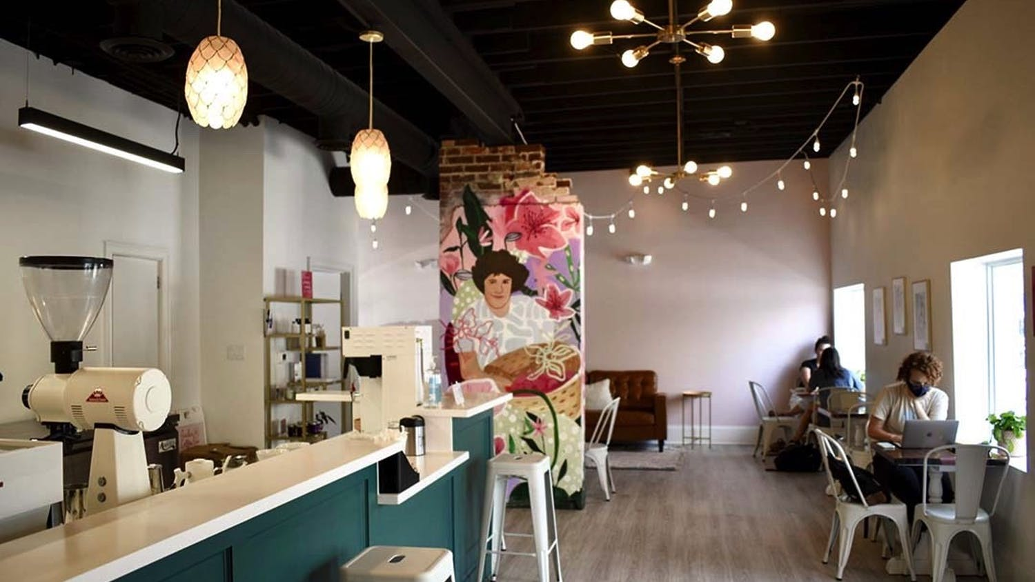 The interior of Azalea Coffee Bar, a chic new woman-owned establishment on Devine Street. The mural is of owner Brittany Koester's mother, and contributes to the shop's goal of uplifting women and reducing disparities in the industry.