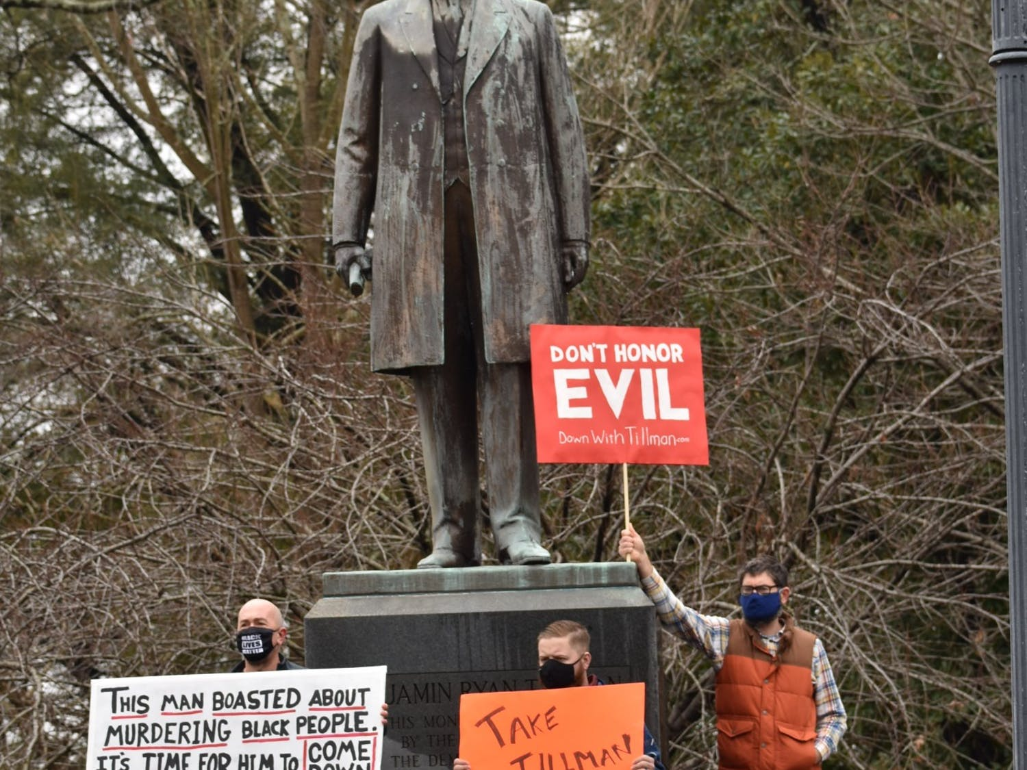 Protestors stand in front of the Benjamin Tillman statue located at the South Carolina Statehouse. The protestors called for the removal of the statue based on Benjamin Tillman's history.