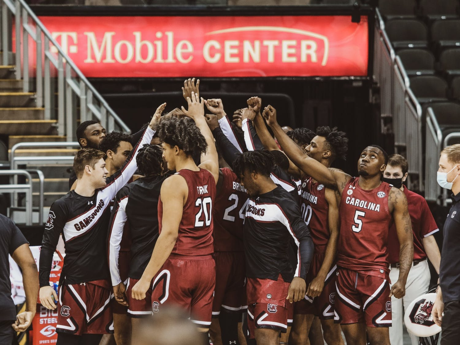 The South Carolina men's basketball team gathers during a timeout in a November game against Liberty. The team is now facing their third COVID-19-related pause of activities this season.