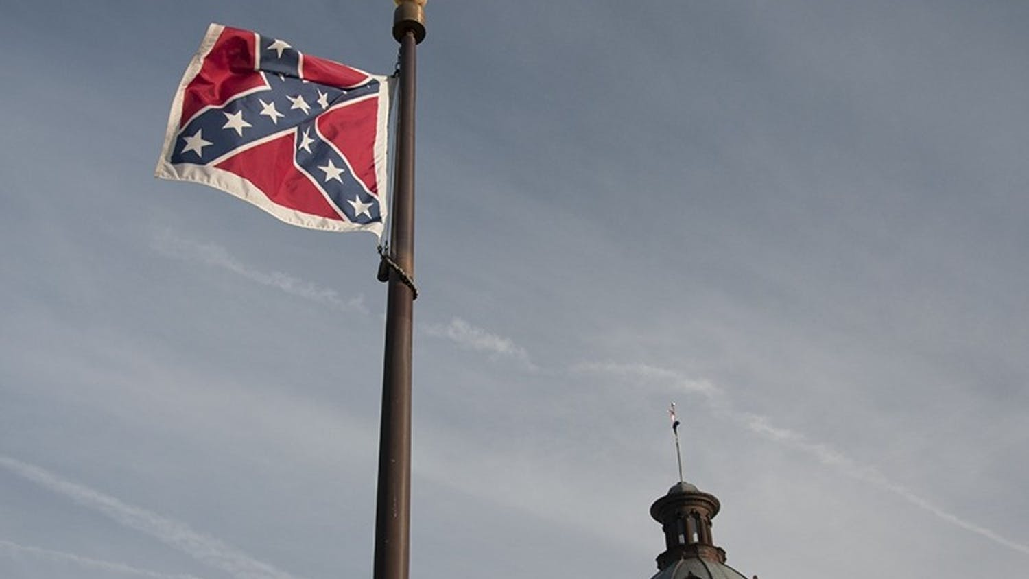 In the spring of 2000, legislation was passed to remove the Confederate battle flag from the State House dome.