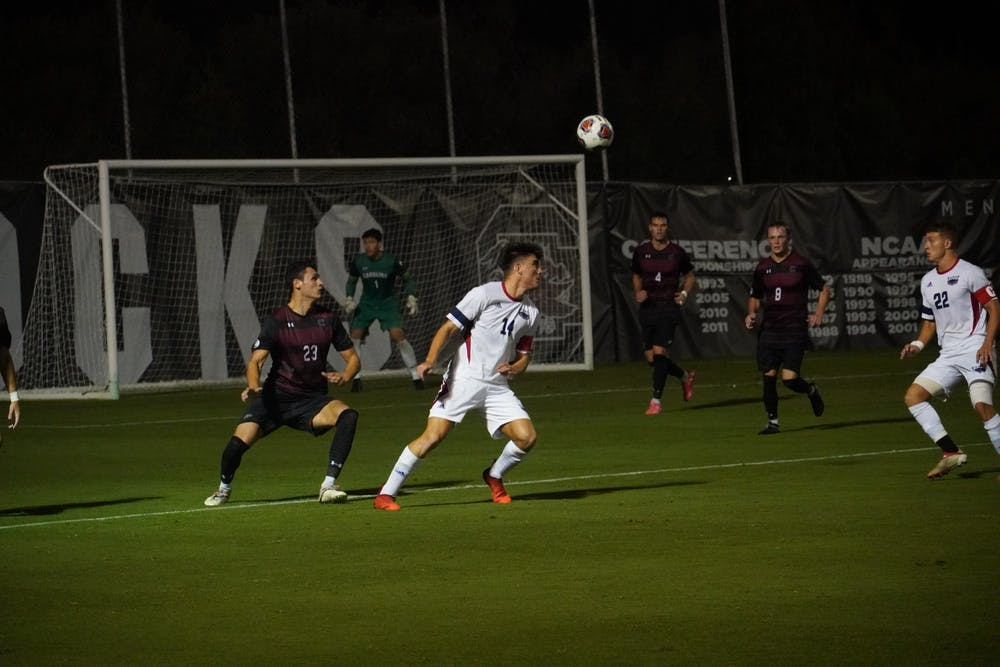 <p>Carolina Gamecocks and Florida Atlantic Owls players battle for the ball. Both looked to pick up momentum for their team. The game ended in a tie.&nbsp;</p>