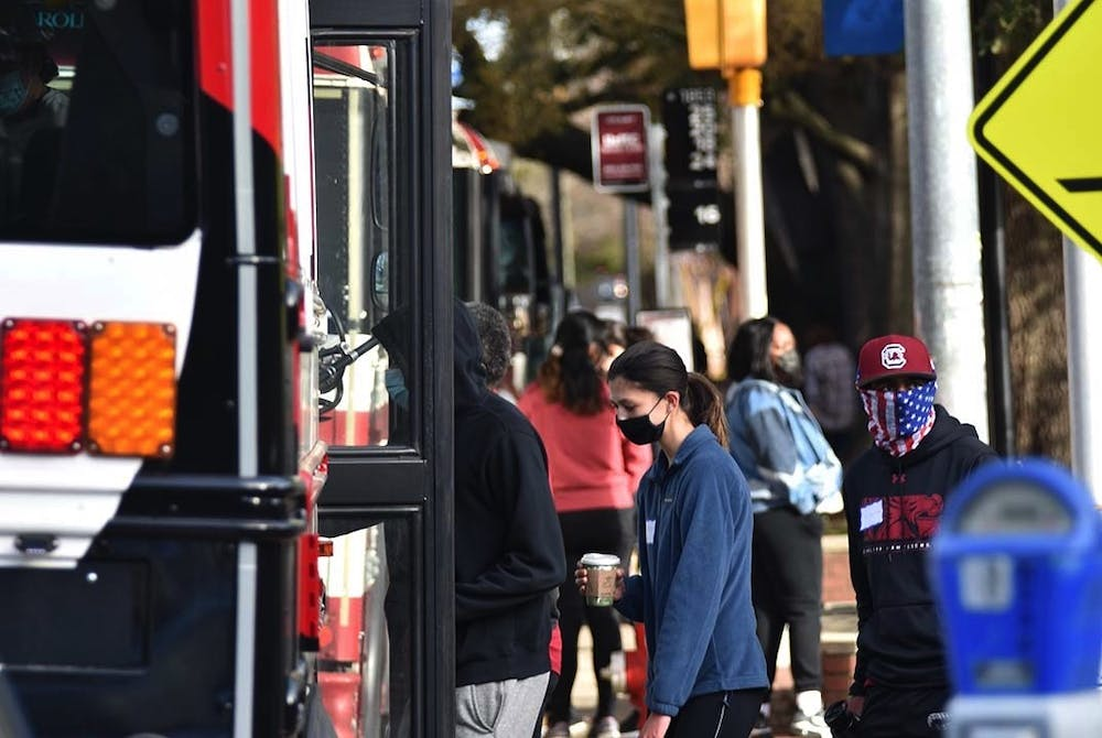 <p>A Central Midlands Regional Transit Authority (COMET) shuttle parked at one of the designated stops around campus as students board the bus. A new rule requires students to swipe their CarolinaCard to board the University of South Carolina affiliated shuttles.</p>