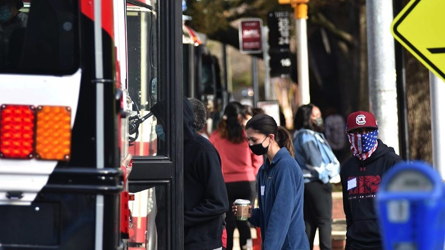 A Central Midlands Regional Transit Authority (COMET) shuttle parked at one of the designated stops around campus as students board the bus. A new rule requires students to swipe their CarolinaCard to board the University of South Carolina affiliated shuttles.