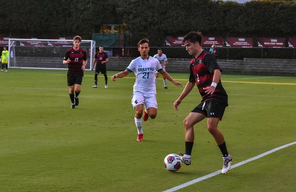 <p>Gamecock junior forward Logan Frost watches sophomore Gamecock Justin Kopay take control of the ball. The Chanticleers beat the Gamecocks 4-1 in a match that saw only 10 Gamecocks on the field for the majority of the game.</p>