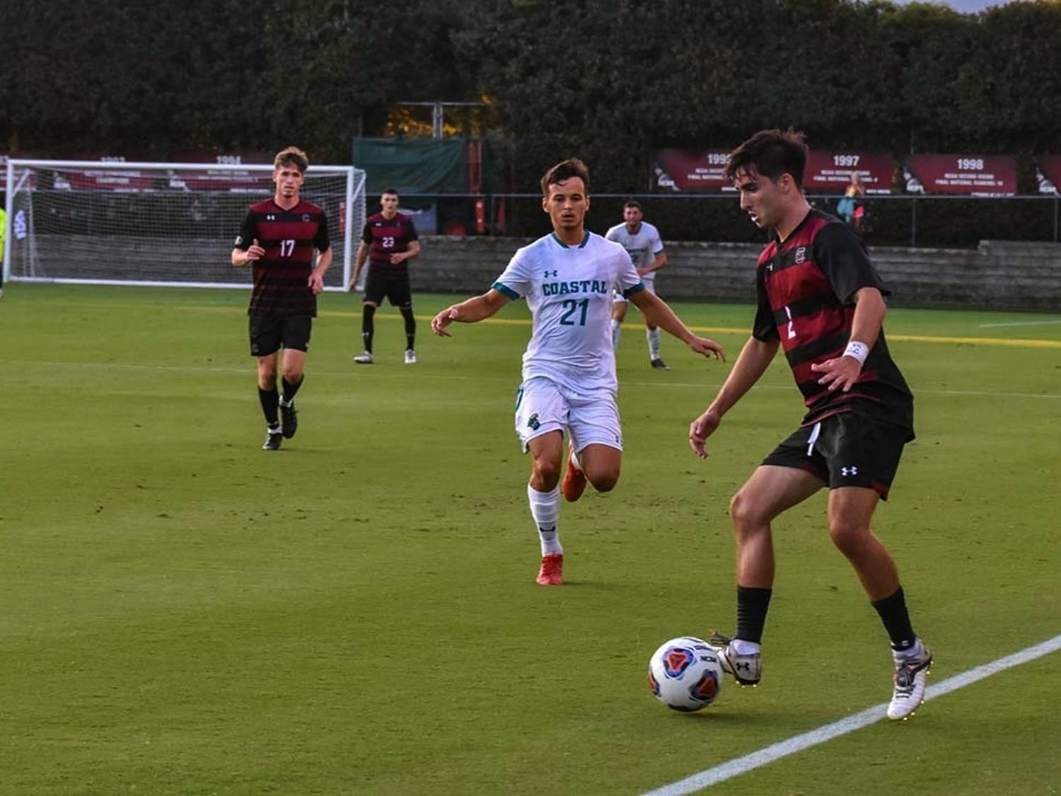 Gamecock junior forward Logan Frost watches sophomore Gamecock Justin Kopay take control of the ball. The Chanticleers beat the Gamecocks 4-1 in a match that saw only 10 Gamecocks on the field for the majority of the game.