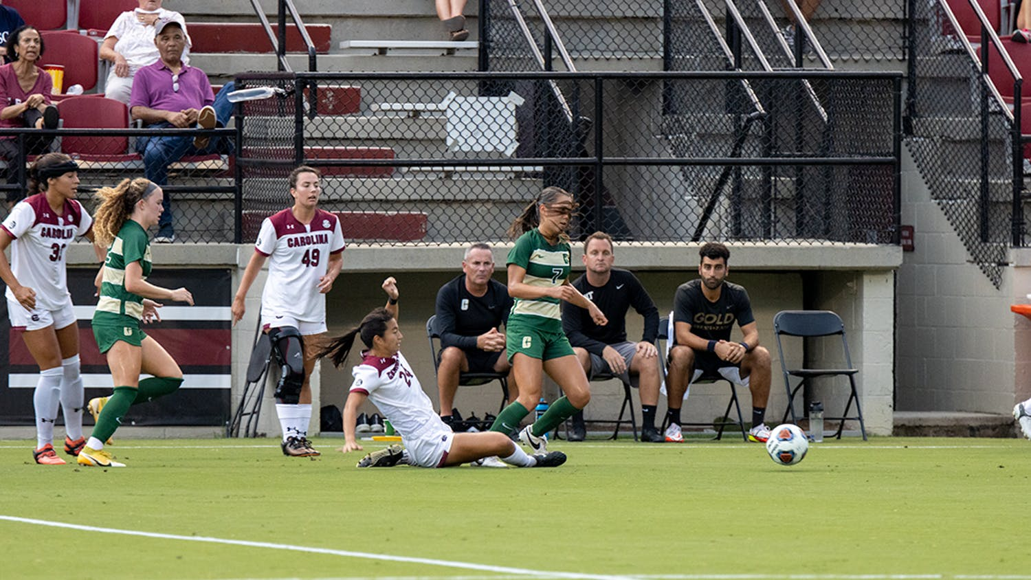 Graduate student midfielder Lauren Chang slides and removes control of the ball from Charlotte player. Chang assisted a goal made by junior forward Eveleen Hahn during the first half.
