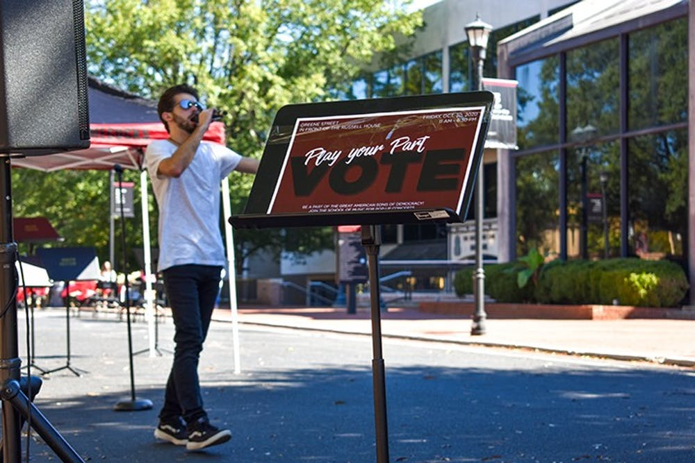 <p>Lead singer of Room XII Mike Stearns performs in front of Russell House on Greene street as part of the Play Your Part campaign. Play Your Part is encouraging people to register and vote in the upcoming election.</p>