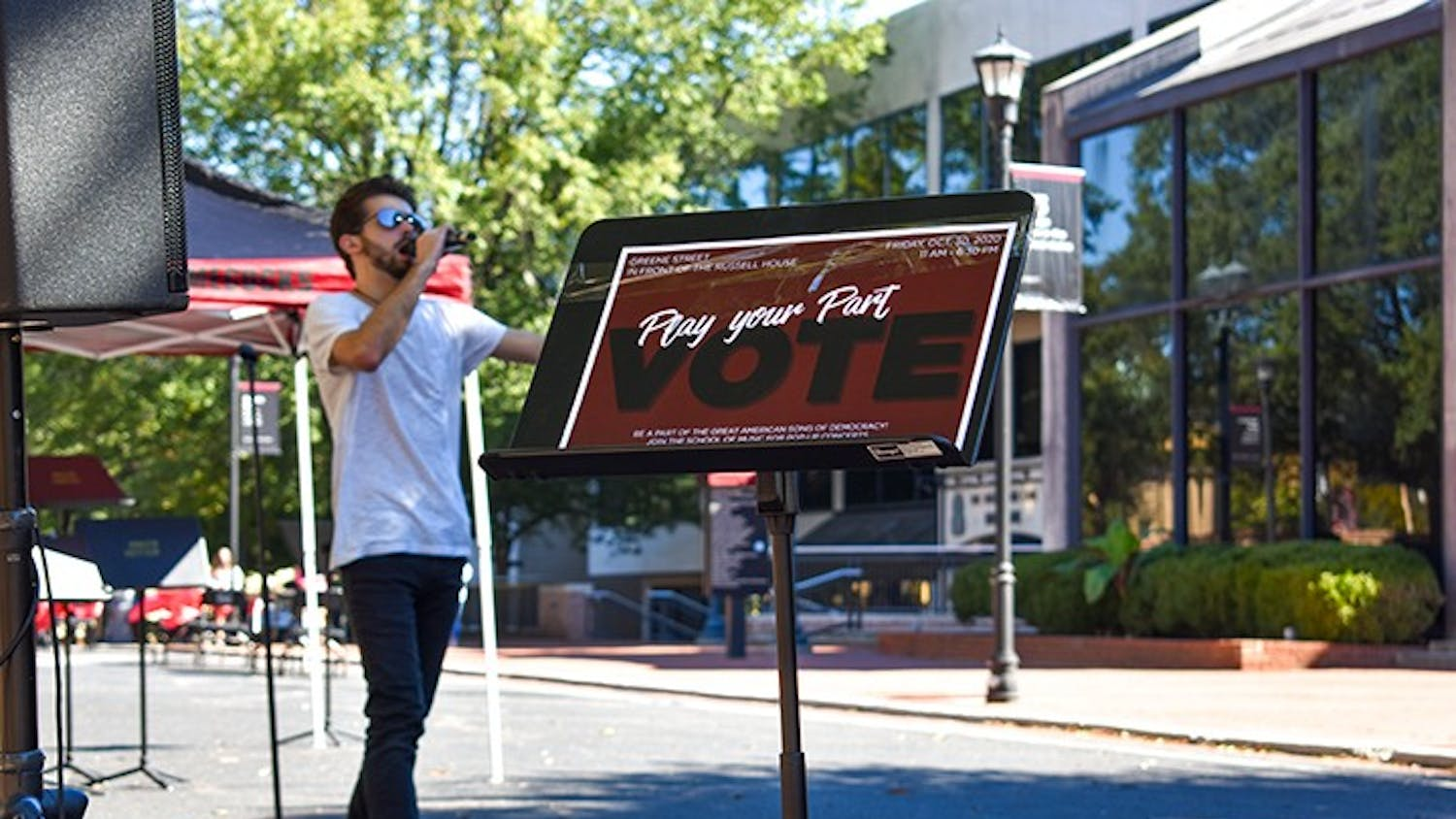 Lead singer of Room XII Mike Stearns performs in front of Russell House on Greene street as part of the Play Your Part campaign. Play Your Part is encouraging people to register and vote in the upcoming election.