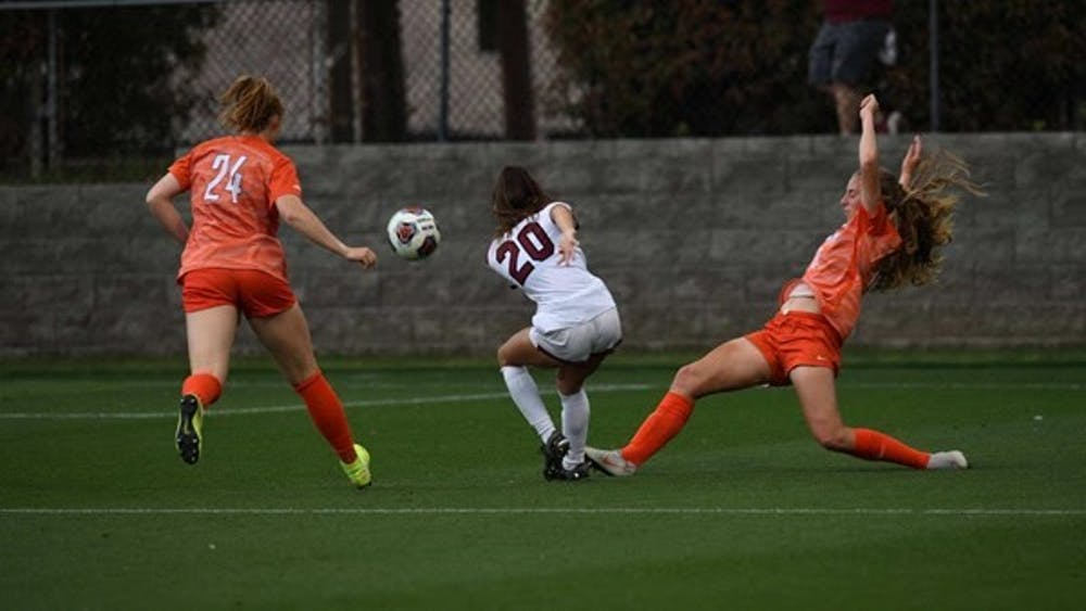 <p>Gamecock freshman forward Corinna Zullo&nbsp;in between two Clemson players during their match on Saturday, April 10, 2021. The Gamecocks lost 2-1.&nbsp;</p>