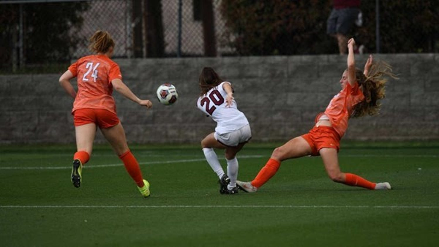 Gamecock freshman forward Corinna Zulloin between two Clemson players during their match on Saturday, April 10, 2021. The Gamecocks lost 2-1.