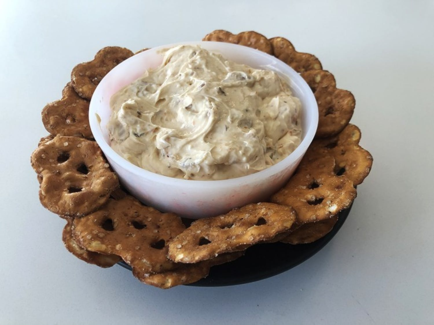 Shrimp dip with a side of pretzels, chips or crackers can be a great alternative to traditional Super Bowl party snacks.