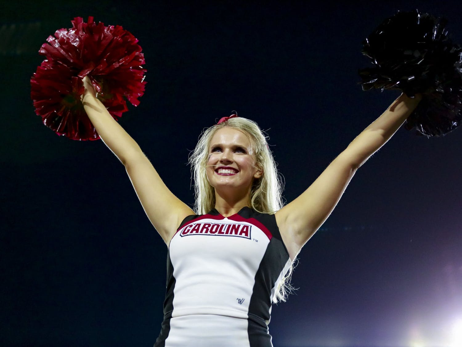 A Gamecock cheerleader performs a stunt during South Carolina's game against Georgia on September 18, 2021.