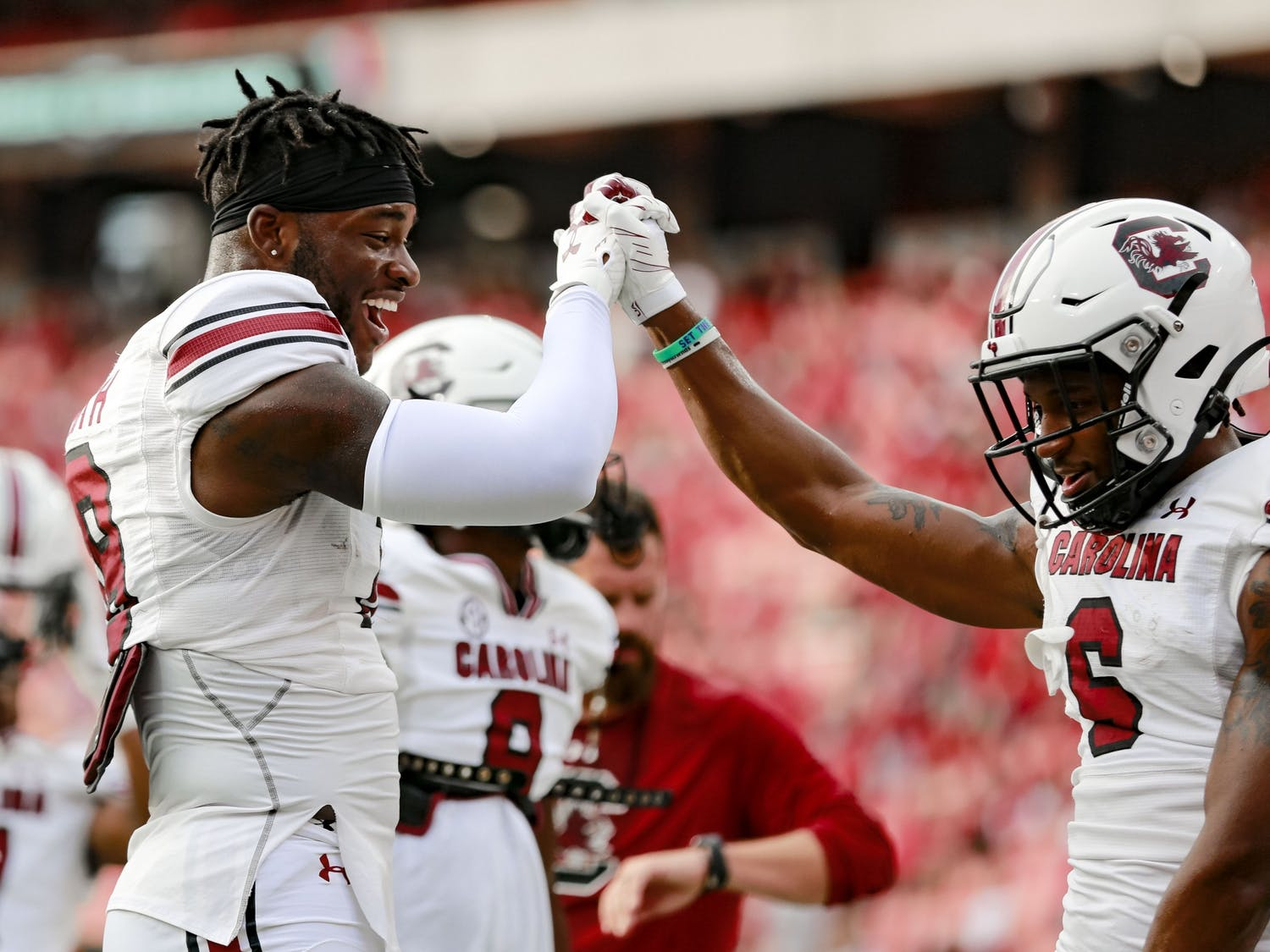 Redshirt sophomore defensive back Cam Smith and senior wide receiver Josh Vann have fun before South Carolina's game against Georgia on Sept. 18, 2021.