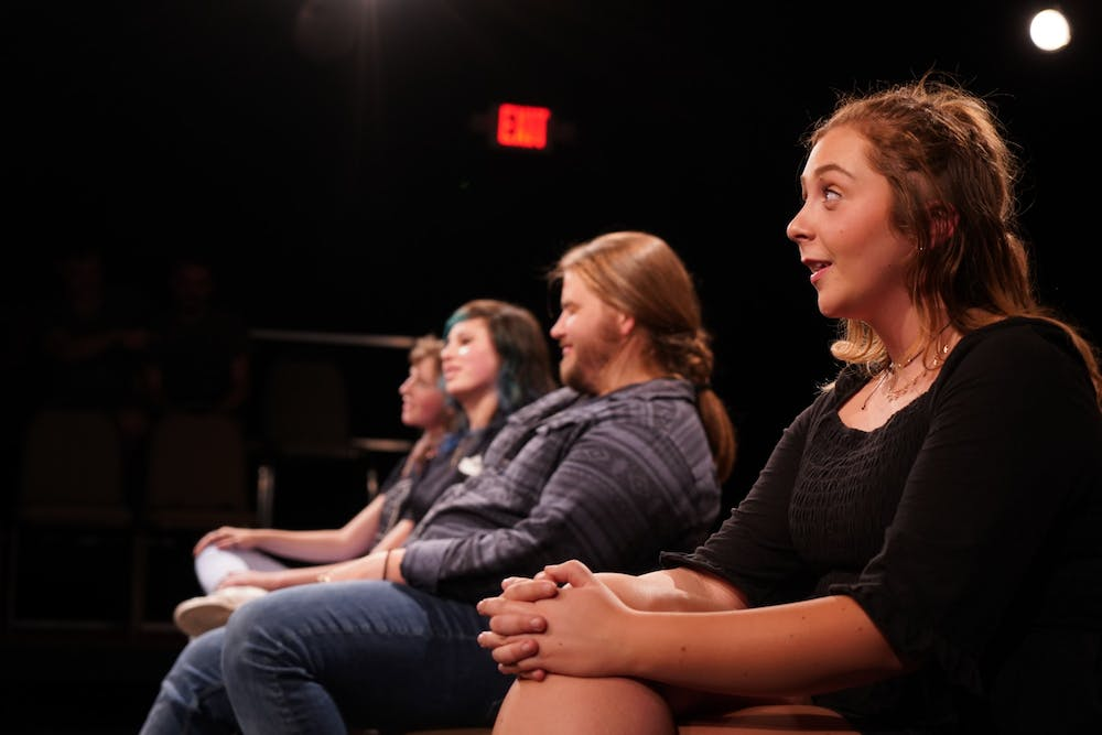"<p>Amber Coulter sits in a row with Casey Downs, Susanna McElveen and Cassidy Spencer during the ""Bon Voyage Prov"" show in April 2019 by the OverReactors Improv club.</p>"