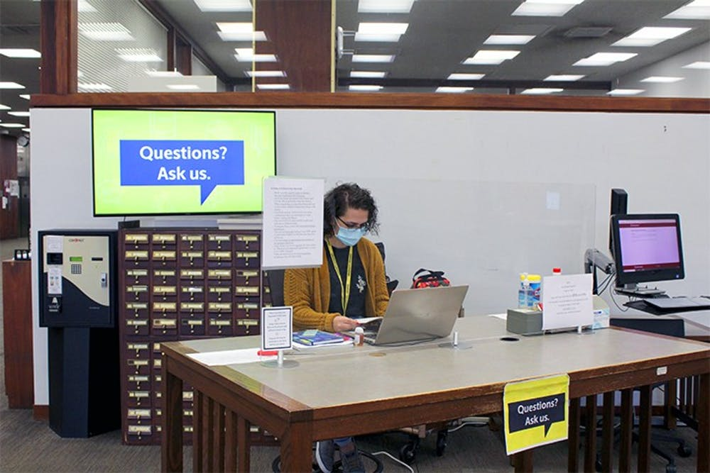 <p>Fourth-year chemical engineering major Mary Wilson works as a library ambassador in the Thomas Cooper Library. A large portion of college students are not eligible to receive the next round of stimulus checks.&nbsp;</p>