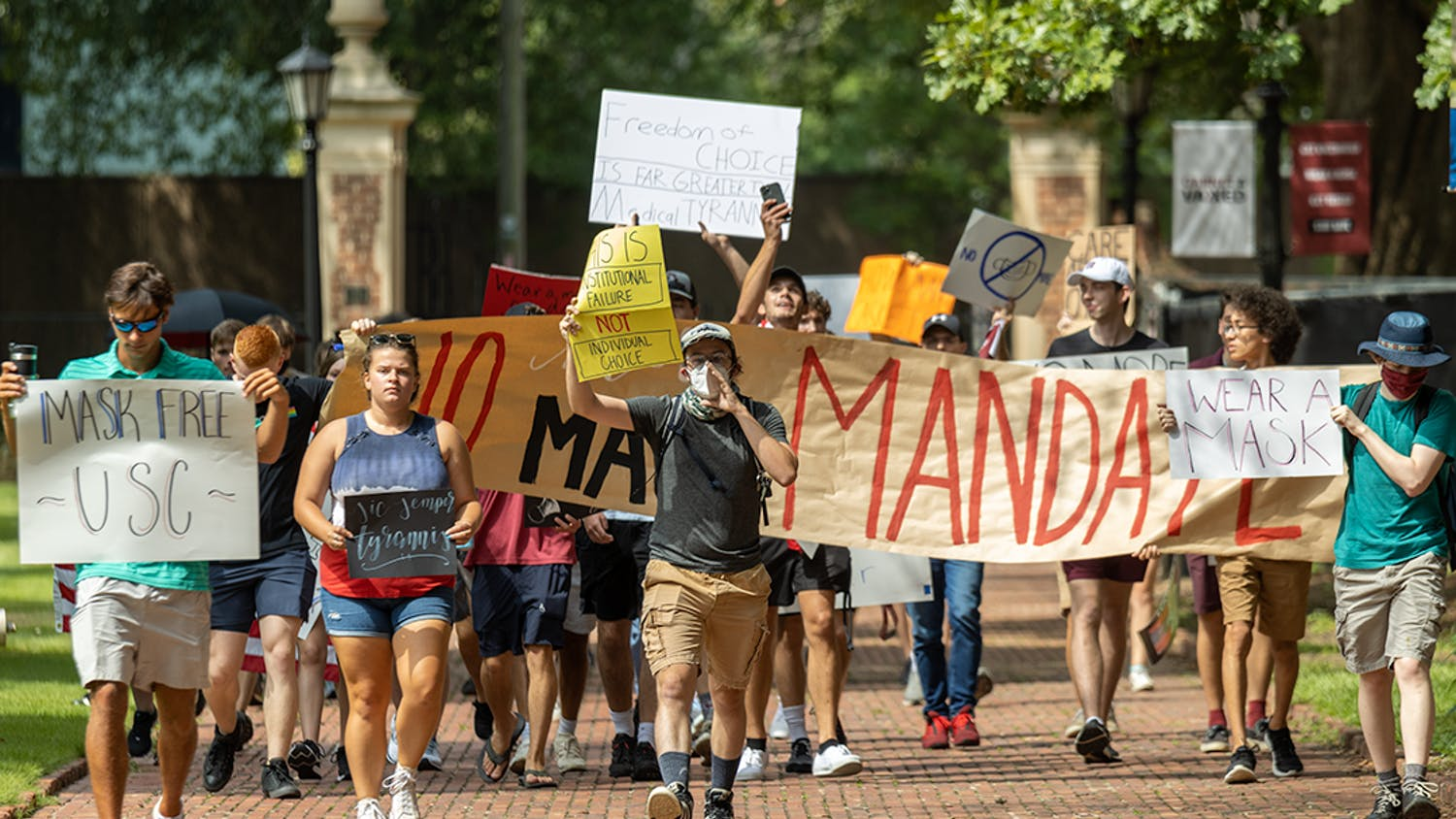 The USC Turning Point USA chapter and the Carolina Socialists protest on the Horseshoe over the mask mandate. The mask mandate was put in place by interim university President Harris Pastides on Aug. 18, 2021.