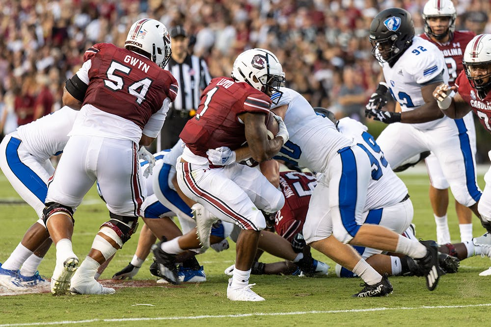 <p>Redshirt freshman running back Marshawn Lloyd breaks free from an Eastern Illinois player on Sept. 4, 2021. Lloyd would go on to make a first down for the Gamecocks.</p>