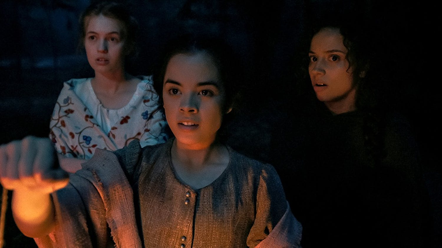 """From left to right: Julia Rehwald, Olivia Scott Welch and Kiana Madeira in """"Fear Street: Part 3 — 1666."""" (Netflix/TNS)"""