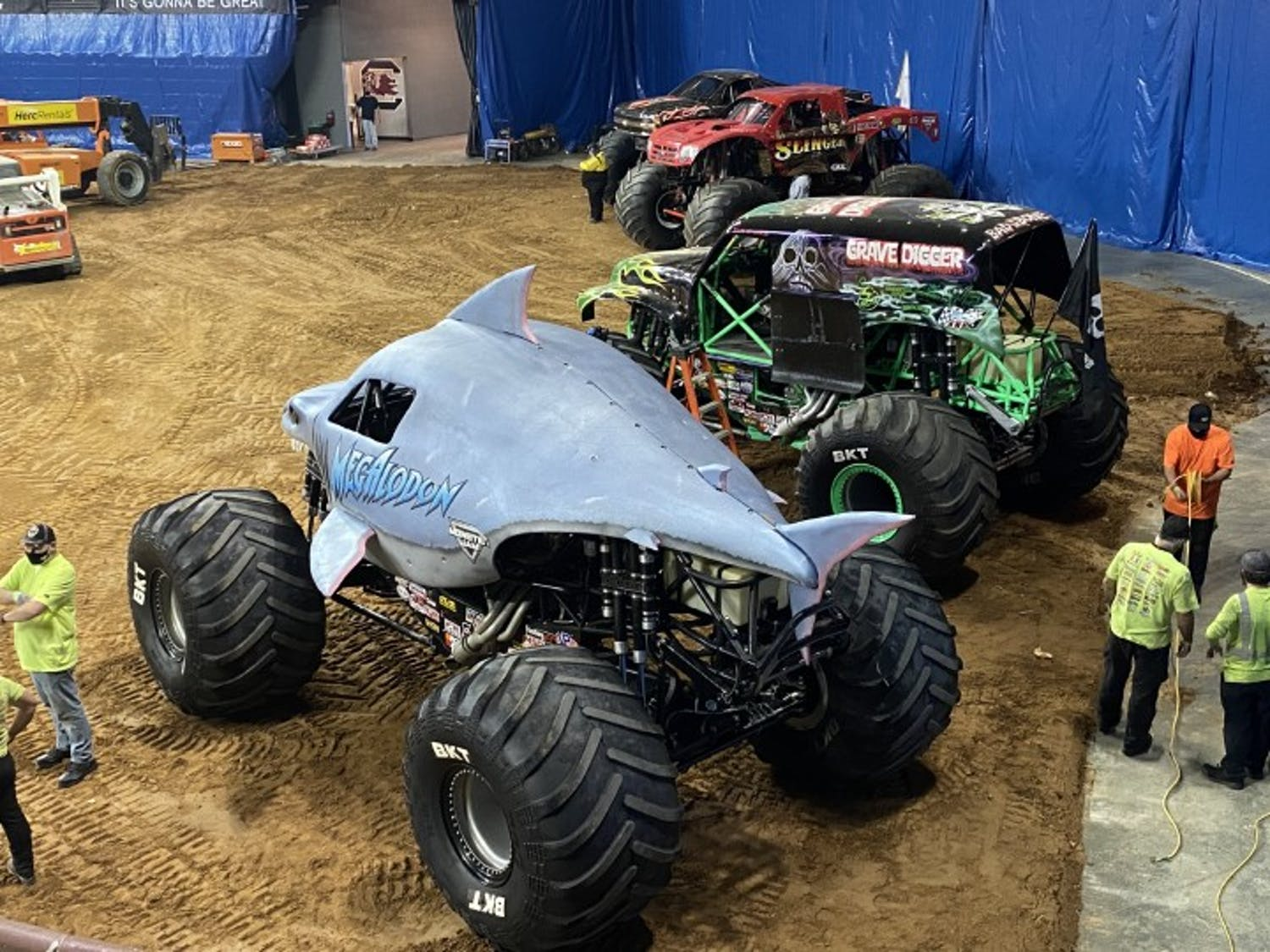 A row of monster trucks sit inside of Colonial Life Arena during Monster Jam's visit to Columbia.