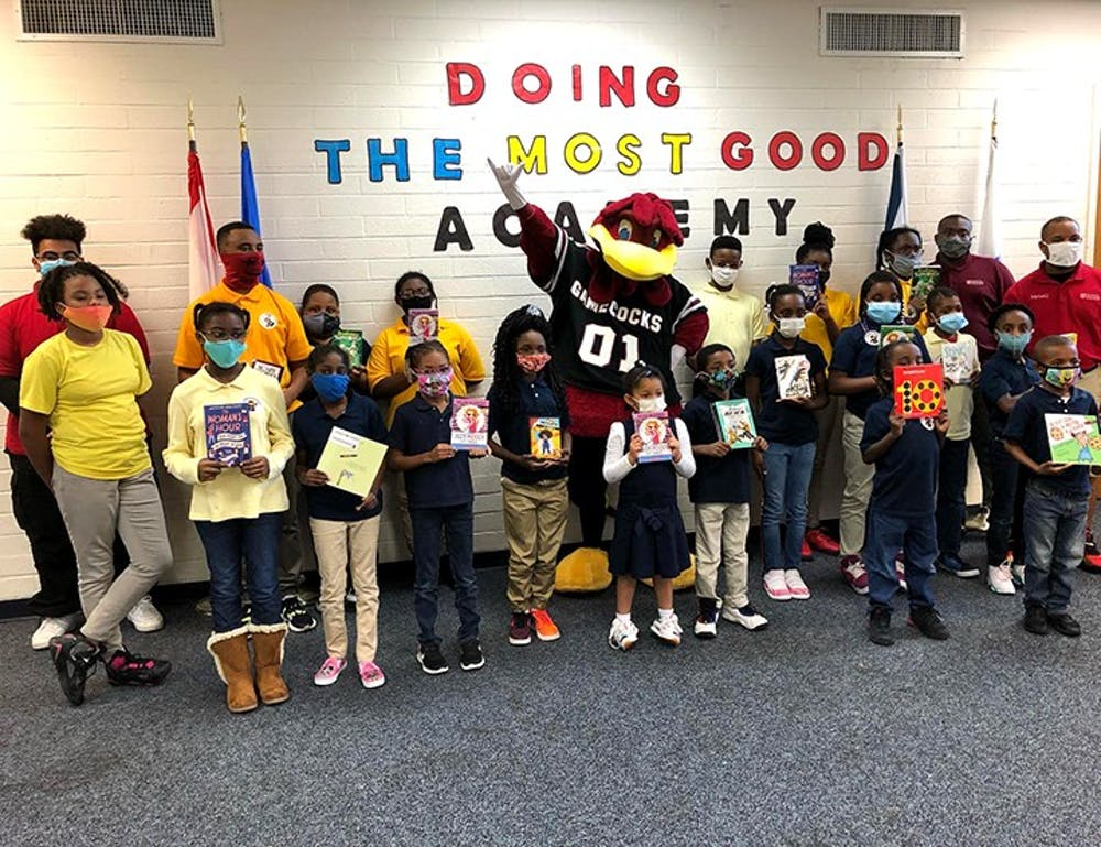 Cocky's Reading Express takes University of South Carolina student volunteers to Title One elementary schools throughout the state to promote the importance of literacy and life-long reading. Every child who makes a promise to Cocky to read every day receives a brand-new book to take home.