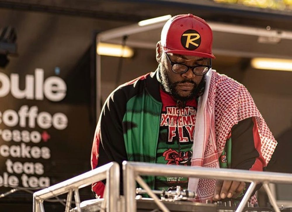 <p>Darian Bethea, known by his stage name Voodoo Child, DJs in front of the Soulé Coffee Truck in Soda City.&nbsp;</p>