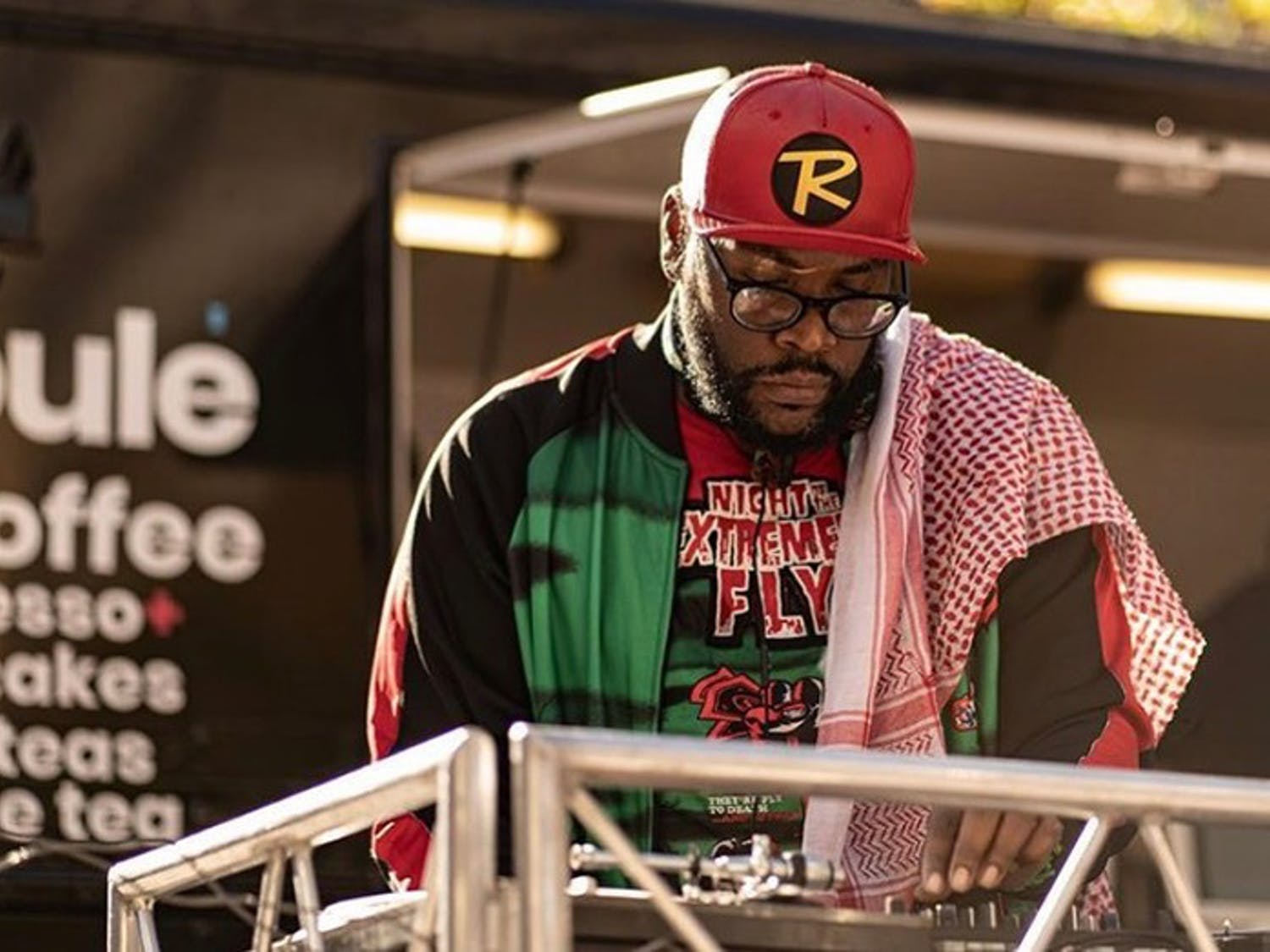 Darian Bethea, known by his stage name Voodoo Child, DJs in front of the Soulé Coffee Truck in Soda City.