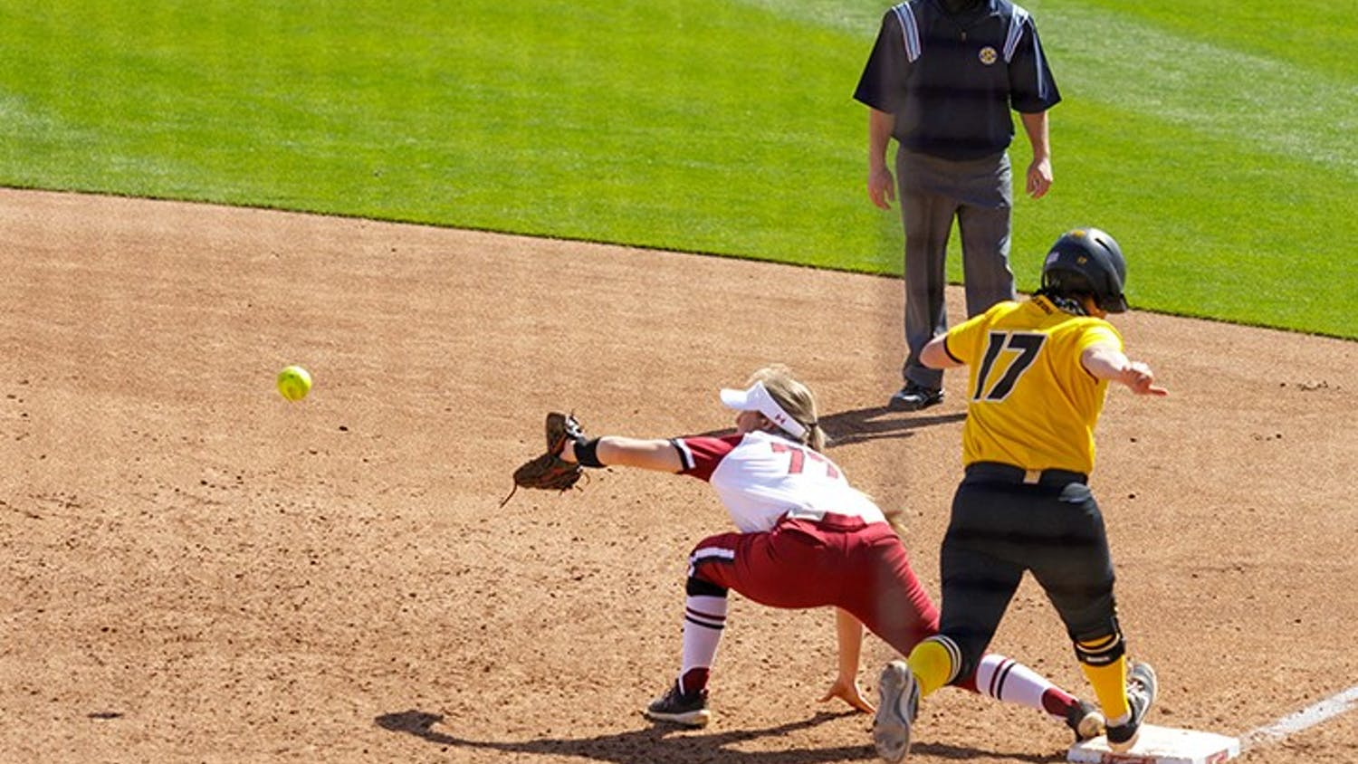 Junior infielder Kassidy Krupit stretches out in hopes of getting Missouri's batter out at first base.