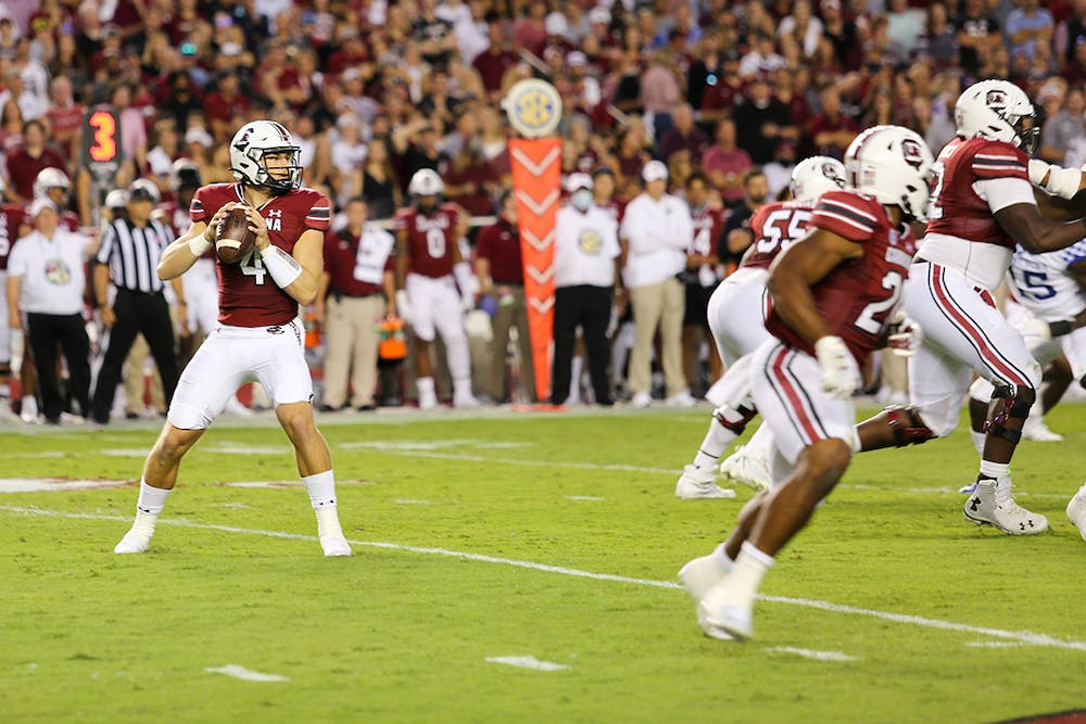 <p>Sophomore quarterback Luke Doty searches downfield for an open receiver for the snap. The Gamecocks ultimately fell to the Kentucky Wildcats with a final score of 16-10.</p>