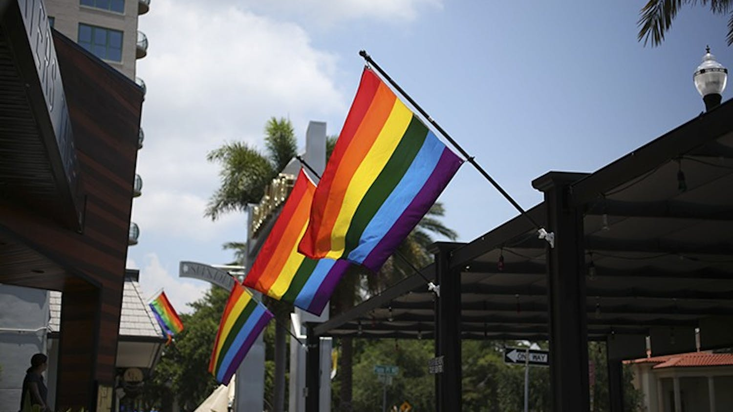 Rainbow flags fly in front of St. Petersburg businesses in preparation for the 2018 Pride parade. On Saturday, a block-long rainbow flag will be unfurled during the Come Out St. Pete Parade. Martha Asencio Rhine  |  Times