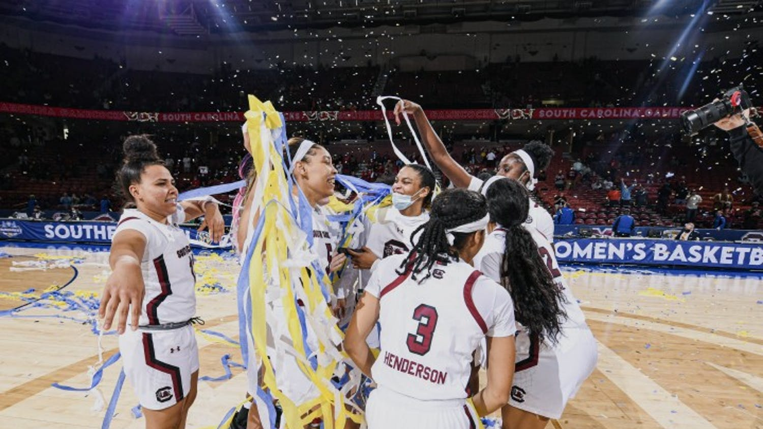 Members of the South Carolina women's basketball team celebrate after defeating Georgia 67-62 in the SEC Championship. This is the team's sixth SEC championship win in seven years.
