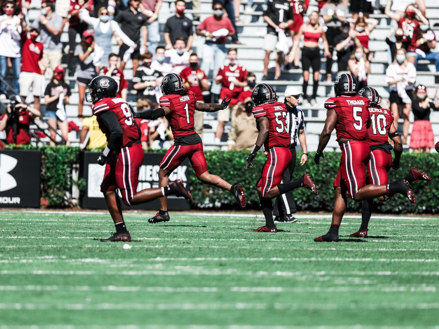 Gamecock defensive players celebrate during the game against the Auburn Tigers. The Gamecocks won 30-22 at home against the Tigers on Saturday, Oct. 17.
