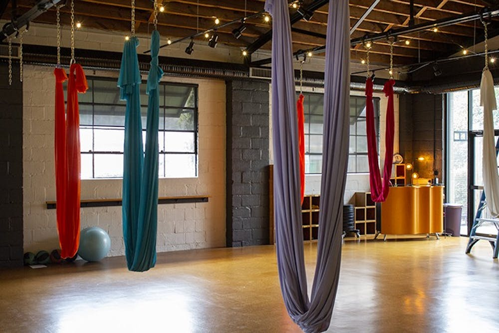 <p>Fit Columbia, located at 2121 College St., is known for its aerial yoga, with colorful silks hanging from the ceiling that help customers soar into the air effortlessly.</p>