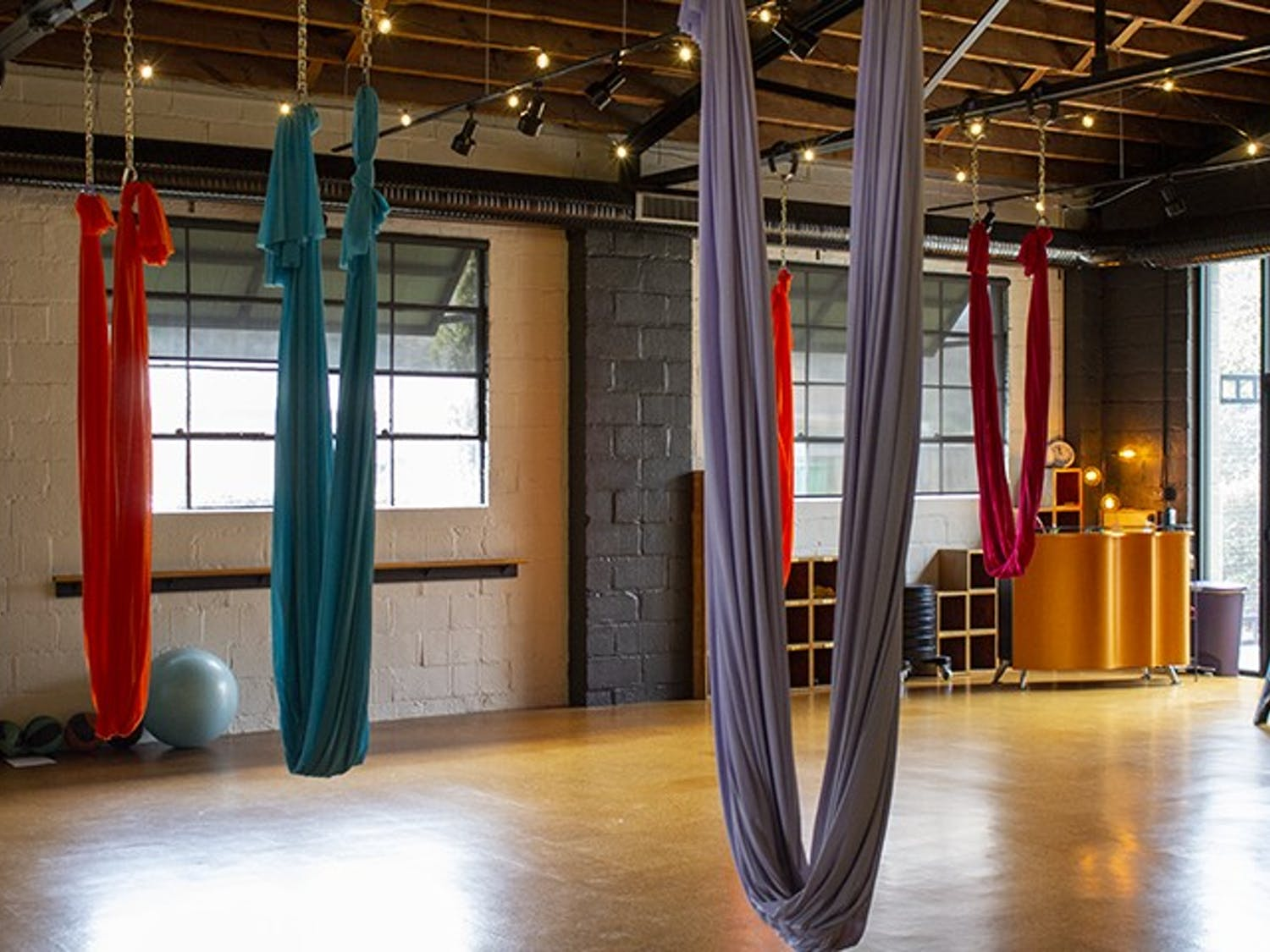 Fit Columbia, located at 2121 College St., is known for its aerial yoga, with colorful silks hanging from the ceiling that help customers soar into the air effortlessly.