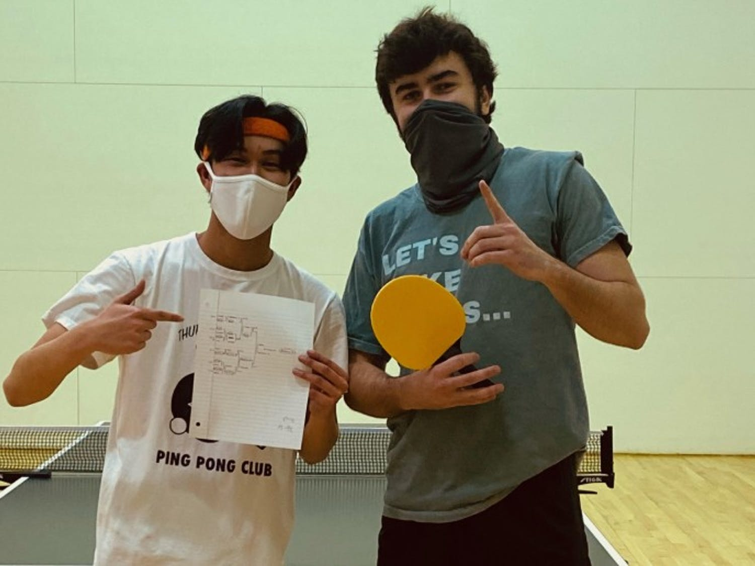 Andrew Nguyen (left) and Jack Brantley (right) pose after a club table tennis tournament. The club has about 40 members who practice every Monday.