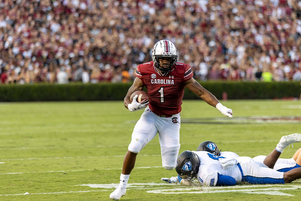 <p>Redshirt freshman running back Marshawn Lloyd evades a tackle attempt made by an Eastern Illinois player. Lloyd made the first down for the Gamecocks.</p>