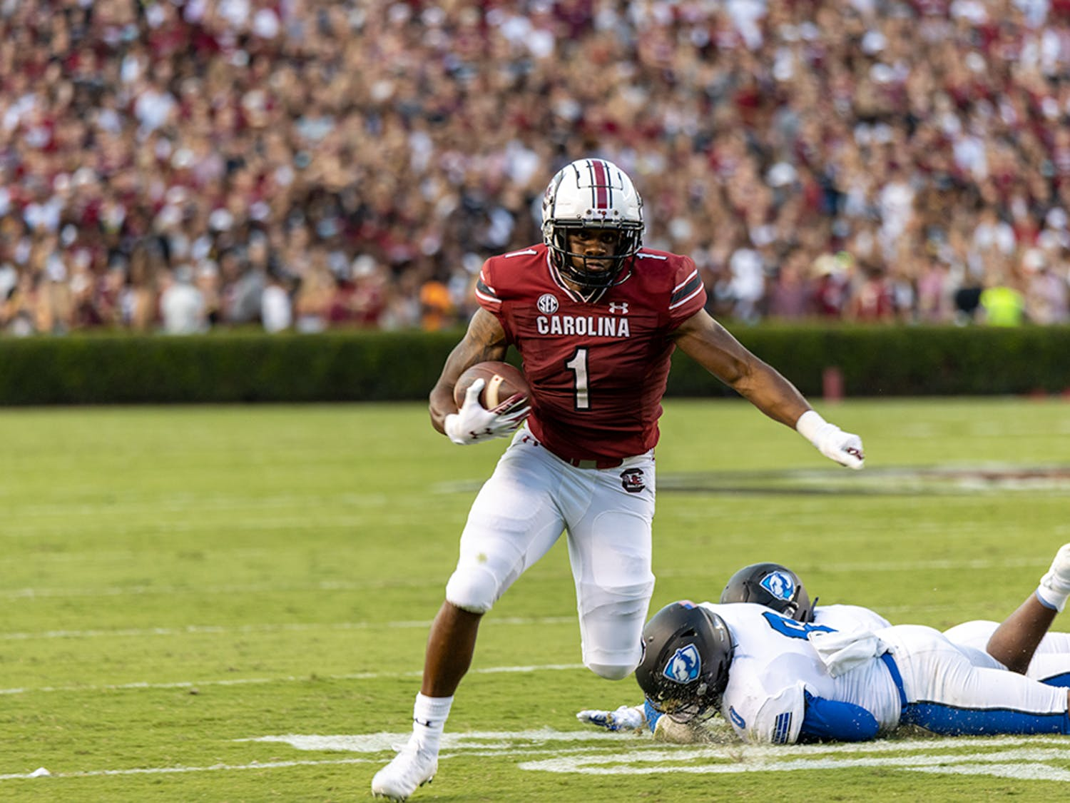 Redshirt freshman running back Marshawn Lloyd evades a tackle attempt made by an Eastern Illinois player. Lloyd made the first down for the Gamecocks.