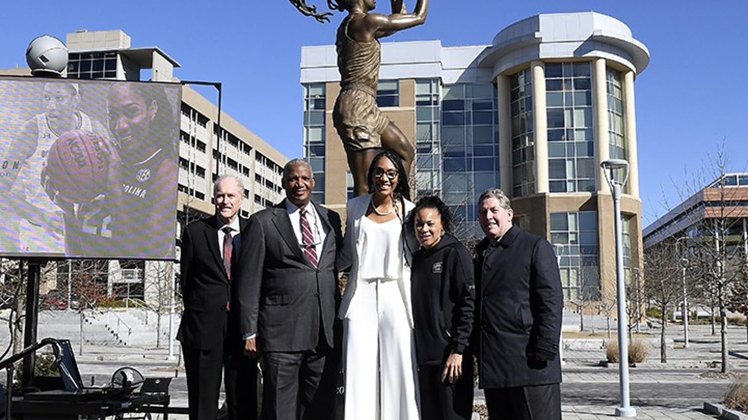 A'ja Wilson standing with Dawn Staley and others in front of her statue that was unveiled in front of Colonial Life Arena on Monday, Jan. 18 2021.