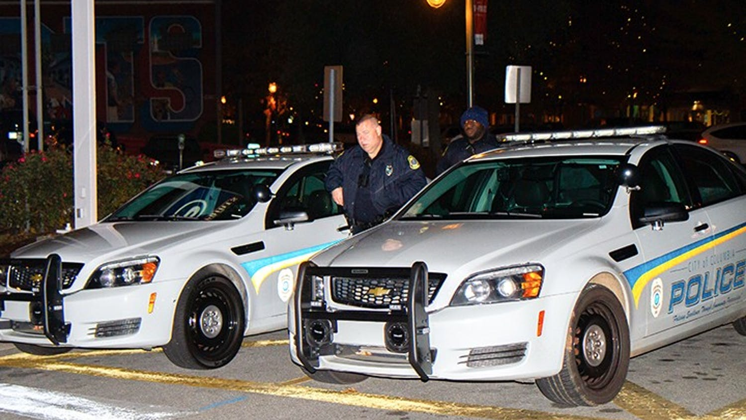 Columbia Police Department officers monitor the streets at night.