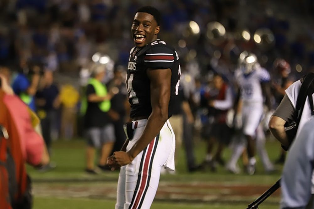 Junior cornerback Israel Mukuamu celebrates after a win against Kentucky in 2019. Mukuamu is one of a growing list of players who has recently decided to opt out of playing this season.